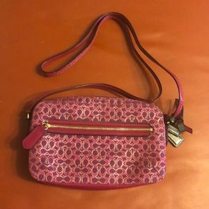 Coach signature magenta crossbody flight bag